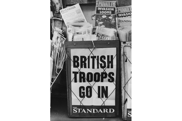 An Evening Standard headline on a London newspaper stand during the Falklands War reads 'British Troops Go In', May 1982. (Photo by Central Press/Hulton Archive/Getty Images)