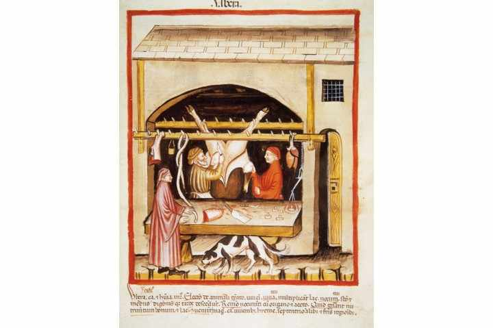 A 14th-century illustration showing medieval butchery. (Photo by Prisma/UIG via Getty Images)