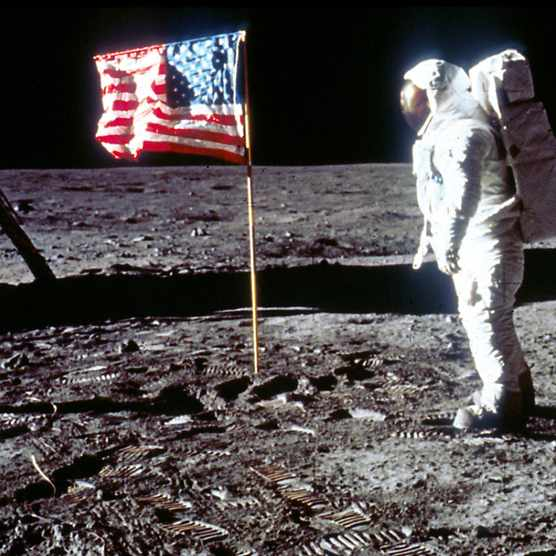 Edwin 'Buzz' Aldrin stands beside an American flag, soon after landing on the Moon as part of the Apollo 11 mission. (Photo by NASA/Liaison)