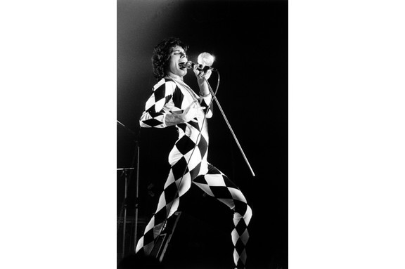 Freddie Mercury – born Farrokh Bulsara – on stage at Brondby Hallen, Denmark. (Photo by Jorgen Angel/Redferns/Getty Images)