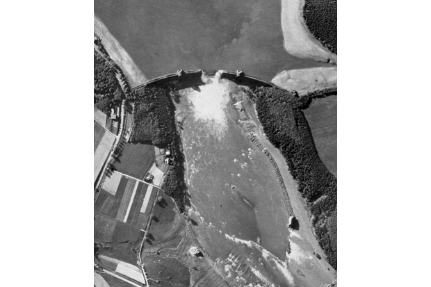 An aerial view of the Mohne dam showing the damage caused by Operation Chastise. The floodwaters killed more than 1,200 people. (Image by Alamy)