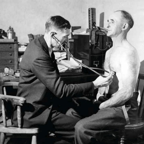 Listening in: a doctor uses a stethoscope to examine a patient in 1948. (Photo by Popperfoto/Getty Images)