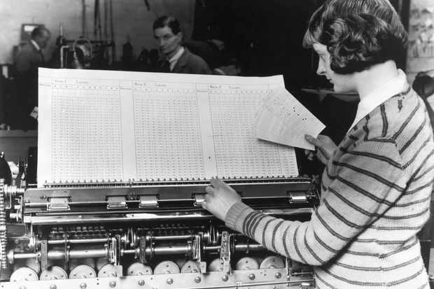 Machines produce the final statistics for a census, c1931. From 1841, censuses helped the government calculate everything from the size and distribution of the population to the contrasting death rate in each of the hundreds of occupations. (Photo by Fox Photos/Getty Images)