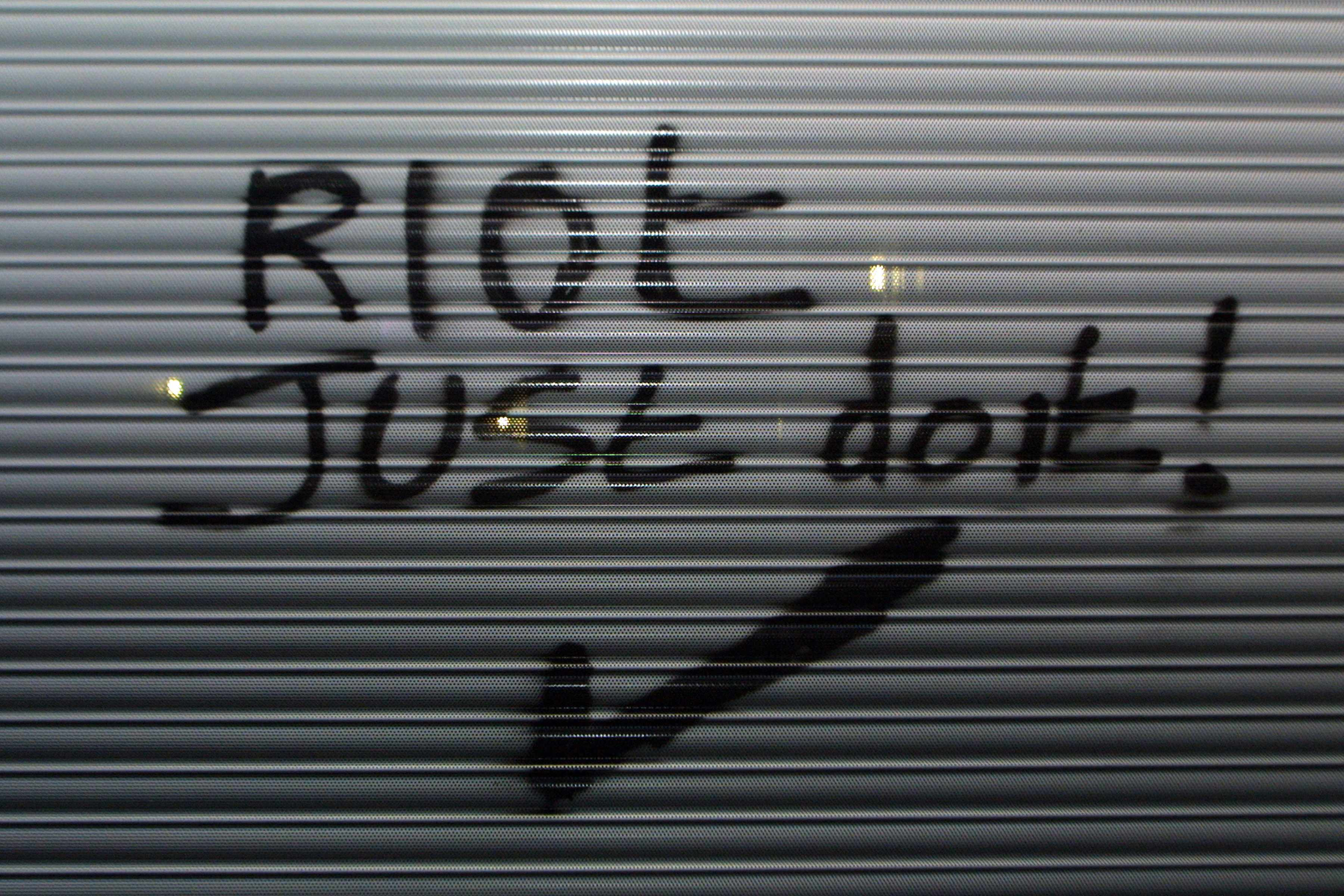 Anti-capitalist graffiti referencing the Nike slogan 'Just Do It'. Mayday riots, London, 2001. (Photo by PYMCA/UIG via Getty Images)