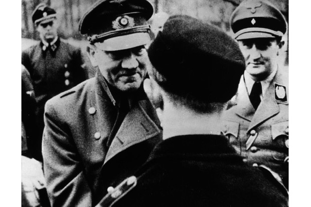 In his last official photo, Adolf Hitler leaves the safety of his bunker to award decorations to members of Hitler Youth. (Photo by Keystone Features/Getty Images)