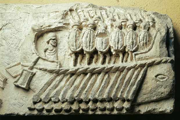 A cast of a Roman warship carrying armed soldiers. (Photo By DEA / G. NIMATALLAH/De Agostini/Getty Images)