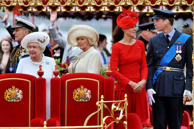 Members of the royal family on board the royal barge 'Spirit of Chartwell'. (Rota/Anwar Hussein/Getty Images)