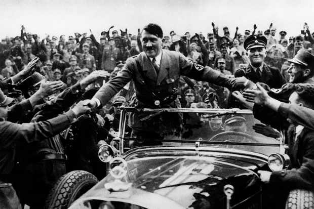 Hitler greets admirers when he was still enormously popular. (Hulton-Deutsch Collection/CORBIS/Corbis via Getty Images)