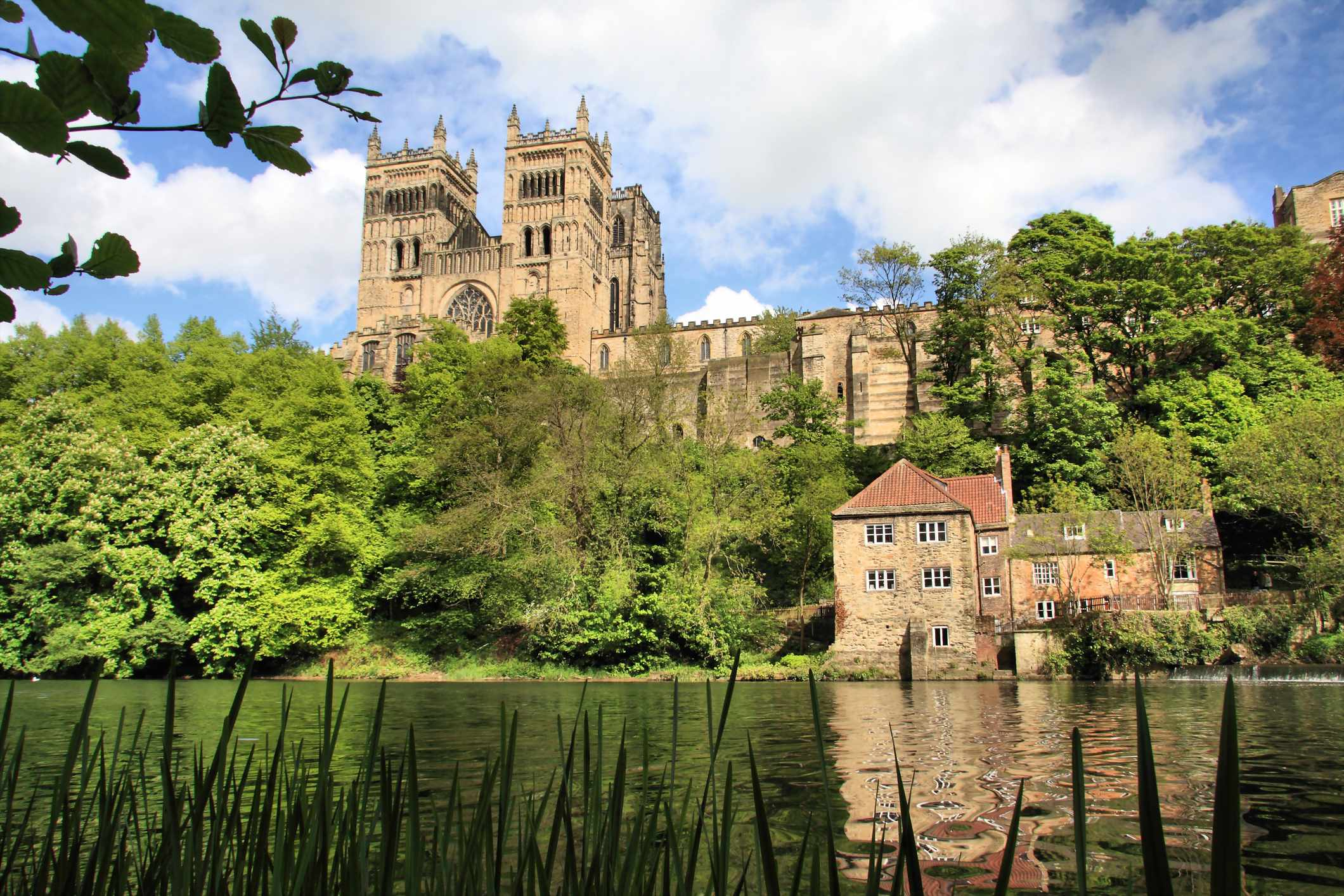 Durham Cathedral on a sunny day. Taken near to the water of the River Wear. (Dreamstime)