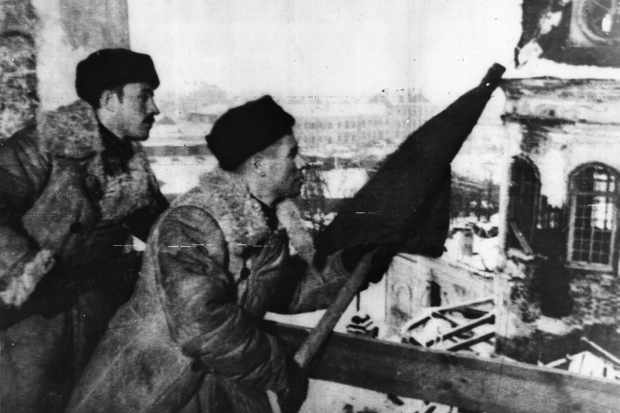 Russian troops hoist the red banner of the Soviet Army after Stalingrad