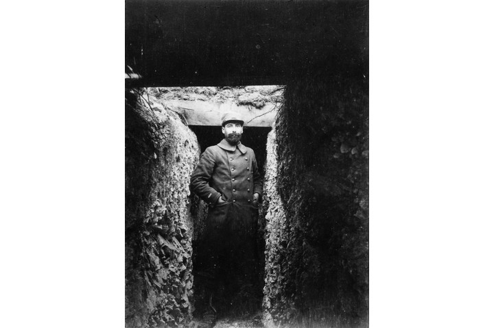 A French soldier standing in the entrance to a trench. (Topical Press Agency/Getty Images)