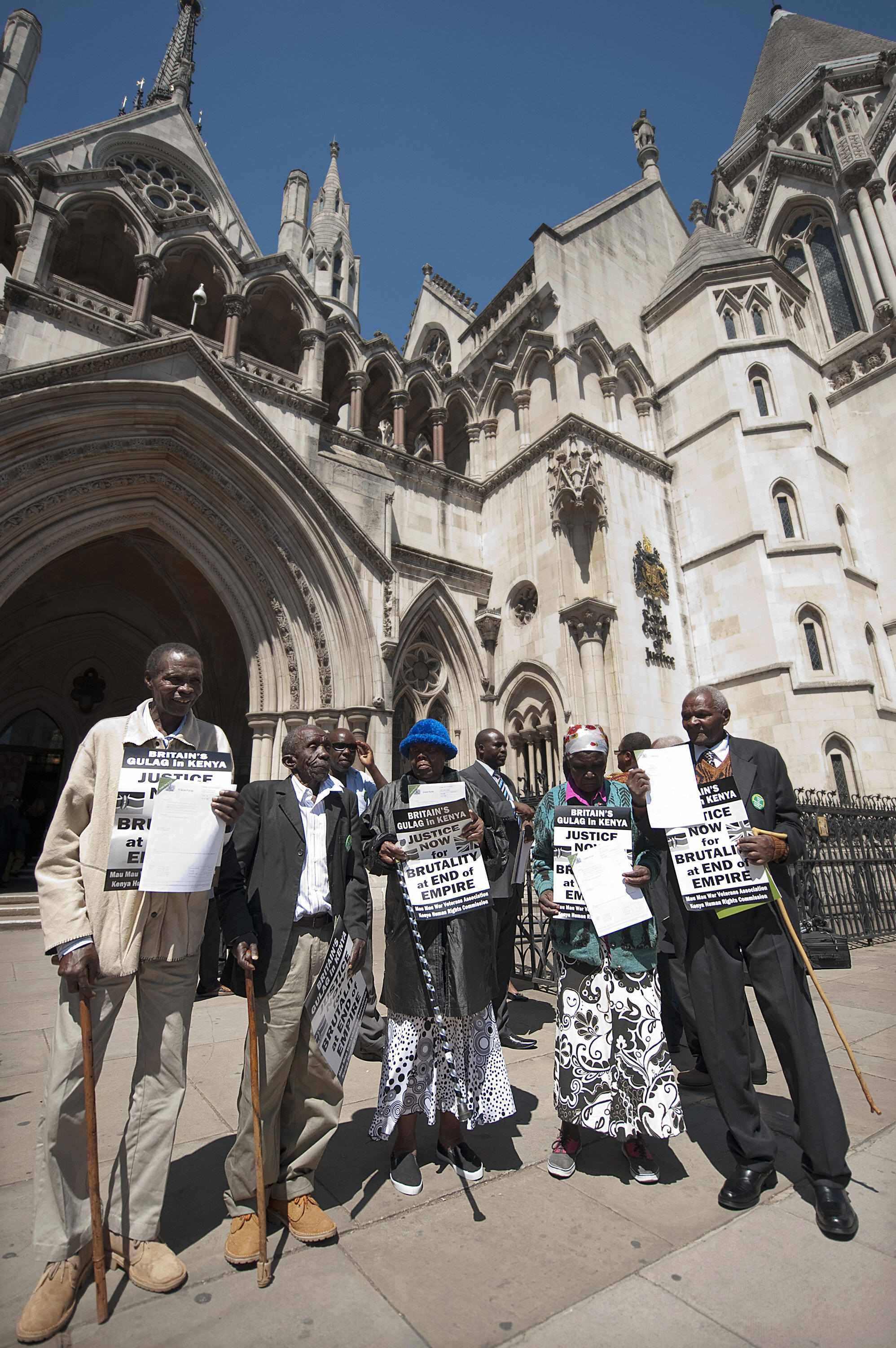 The three Kenyans who were tortured by British forces in the 1950s are joined by supporters at a demonstration outside the Royal Courts of Justice. (BEN STANSALL/AFP/Getty Images)
