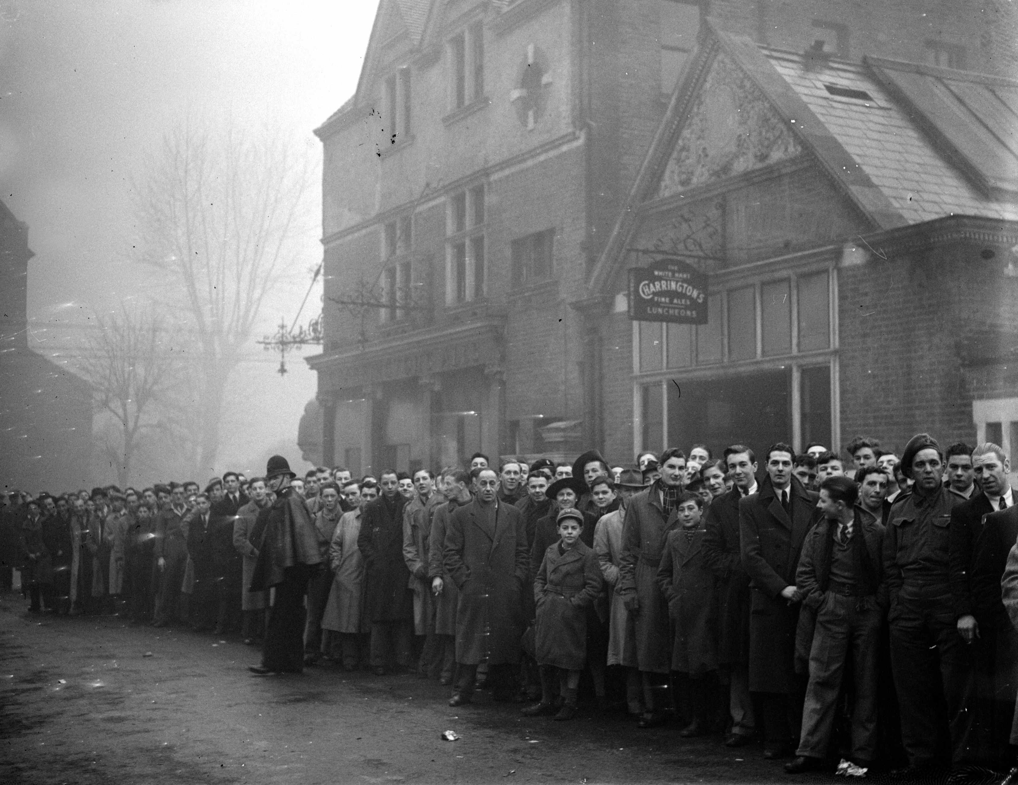 Sport offered the two sides the perfect stage on which to get one over on the 'enemy', says Dominic Sandbrook. Pictured here is a queue for a football match between Arsenal and Dynamo Moscow. (Photo by Hulton Archive/Getty Images)