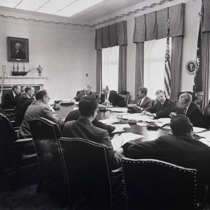 President Kennedy in a meeting with his cabinet officers and advisers. (Getty Images)