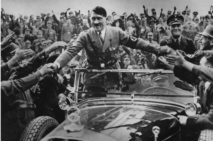 1933: Adolf Hitler (1889–1945), chancellor of Germany, is welcomed by supporters at Nuremberg. (Photo by Hulton Archive/Getty Images)