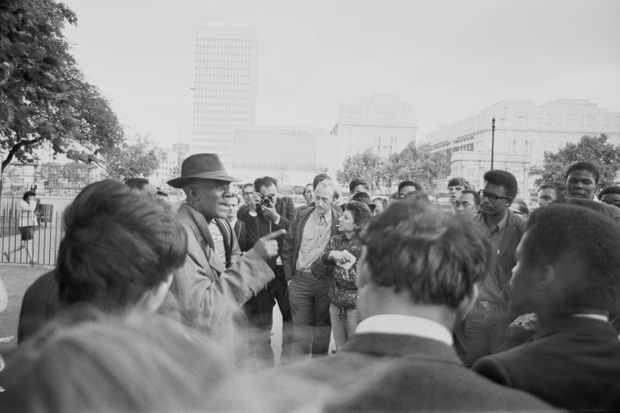 Afro-Trinidadian historian, journalist and socialist Cyril Lionel Robert James talking to a group of students at Speakers' Corner, London, in 1967. (Photo by Roy Milligan/Daily Express/Getty Images)
