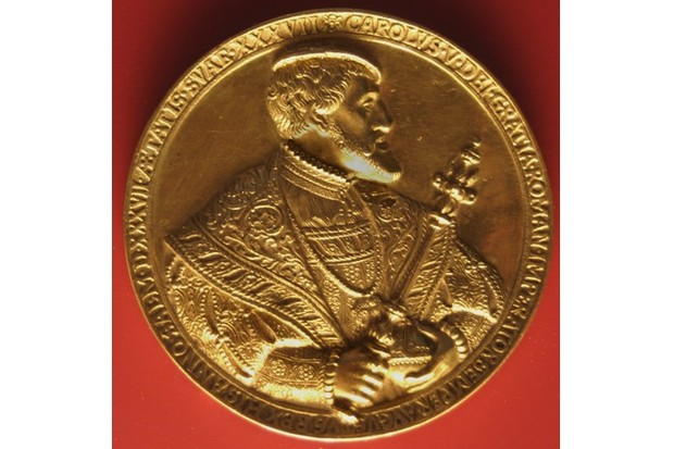 Charles V depicted on a 16th-century gold coin.