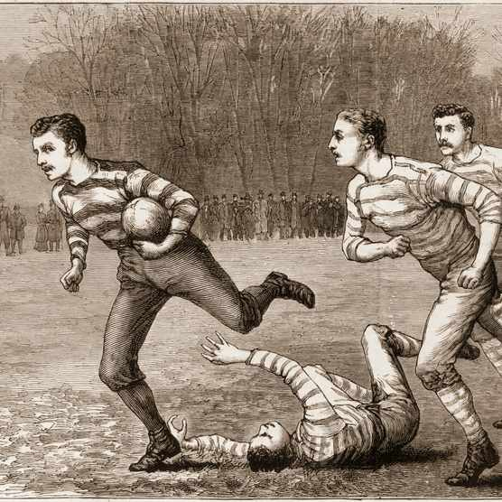 Wood engraving from The Graphic magazine features an illustration of a young man running with the ball during a football match on a grassy field, late 19th century. (Photo by Stock Montage/Getty Images)