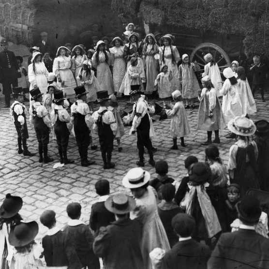 Morris dancers perform