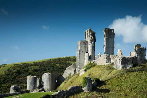 The ruins of 11th-century Corfe Castle in Dorset, England