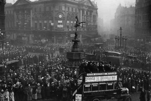 Crowds celebrate the anniversary of the armistice at Piccadilly Circus, London. (Topical Press Agency/Getty Images)