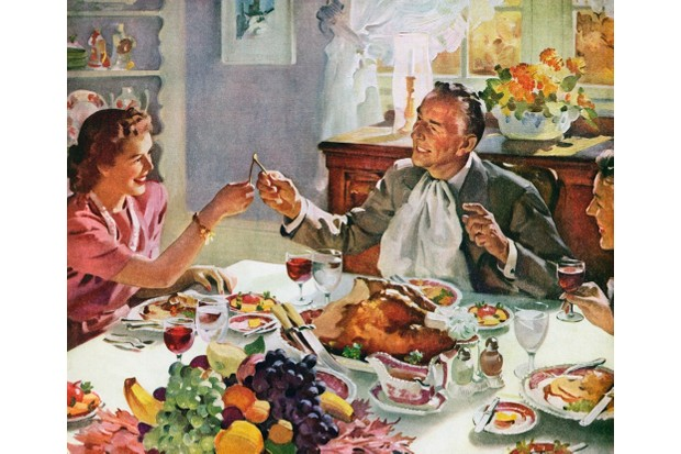 Vintage illustration of a husband and wife pulling the wishbone of a turkey for good luck at Thanksgiving dinner; screen print, 1942. (Photo by GraphicaArtis/Getty Images)