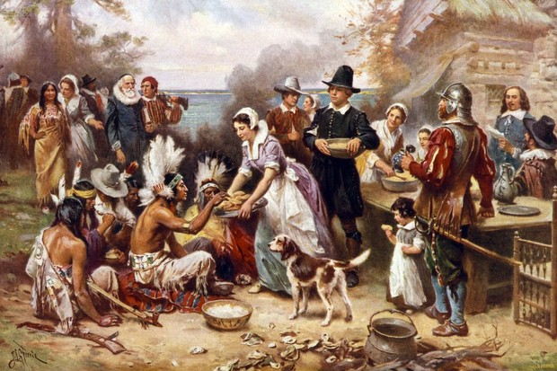 The First Thanksgiving in 1621, after a painting by Jean-Léon Gérôme; screen print, 1932. (Photo by GraphicaArtis/Getty Images)