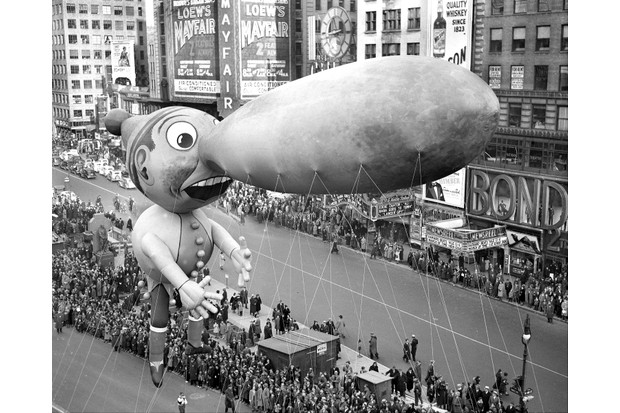 Balloons float down Broadway in the 13th annual Macy's Thanksgiving Day Parade, 25 November 1937. (Photo by Walter Kelleher/NY Daily News Archive via Getty Images)