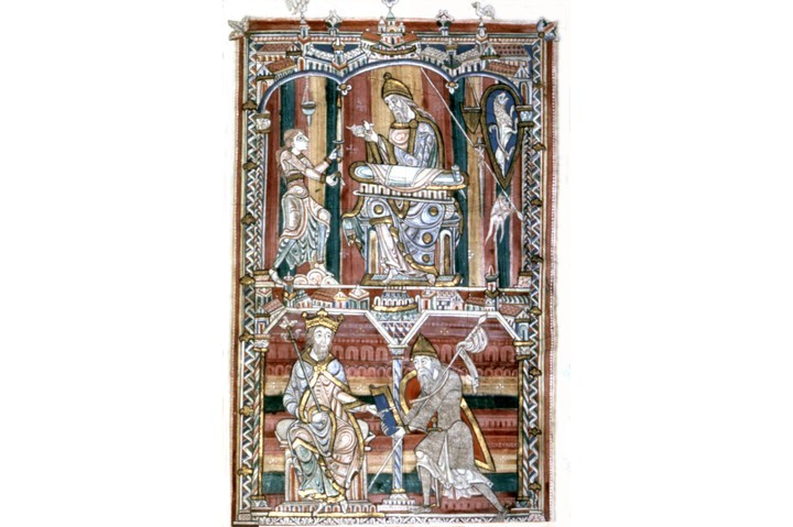 Pliny the Elder depicted in a mid-12th century miniature, writing and giving his book to Roman emperor Vespasian. (Photo by Photo12/UIG/Getty Images)