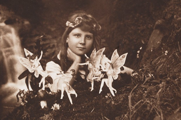 Frances Griffiths poses with the fairies