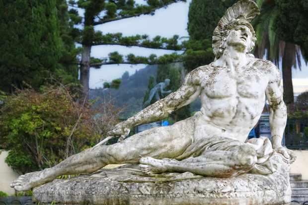 A stone statue of Achilles