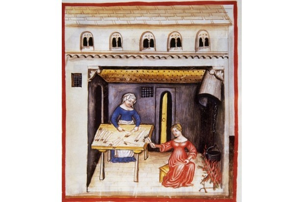 Women cutting pig's trotters. From Tacuinum Sanitatis, a medieval handbook of health (14th century). Miniature. Fol. 78 r. (Photo by: Prisma/UIG via Getty Images)
