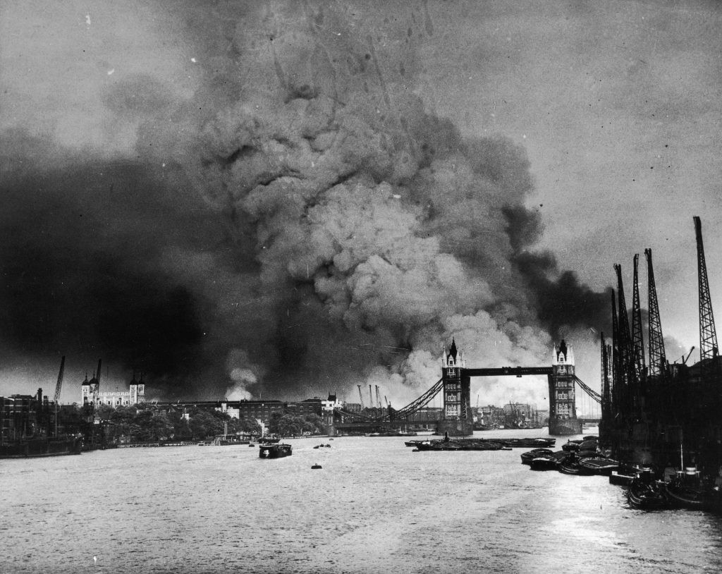 London burns behind Tower Bridge on 7 September 1940, the day of the first mass air raid on the capital. Some 448 Britons were killed in the raid.  (Photo by Fotosearch/Getty Images)