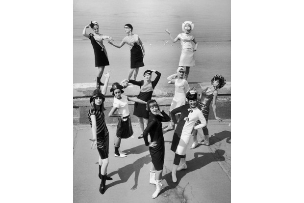 Ten dancers from a music hall troop present the new collection from the fashion designer Angela Cash on Blackpool beach in 1965. (Credit: Keystone-France/Gamma-Keystone via Getty Images)