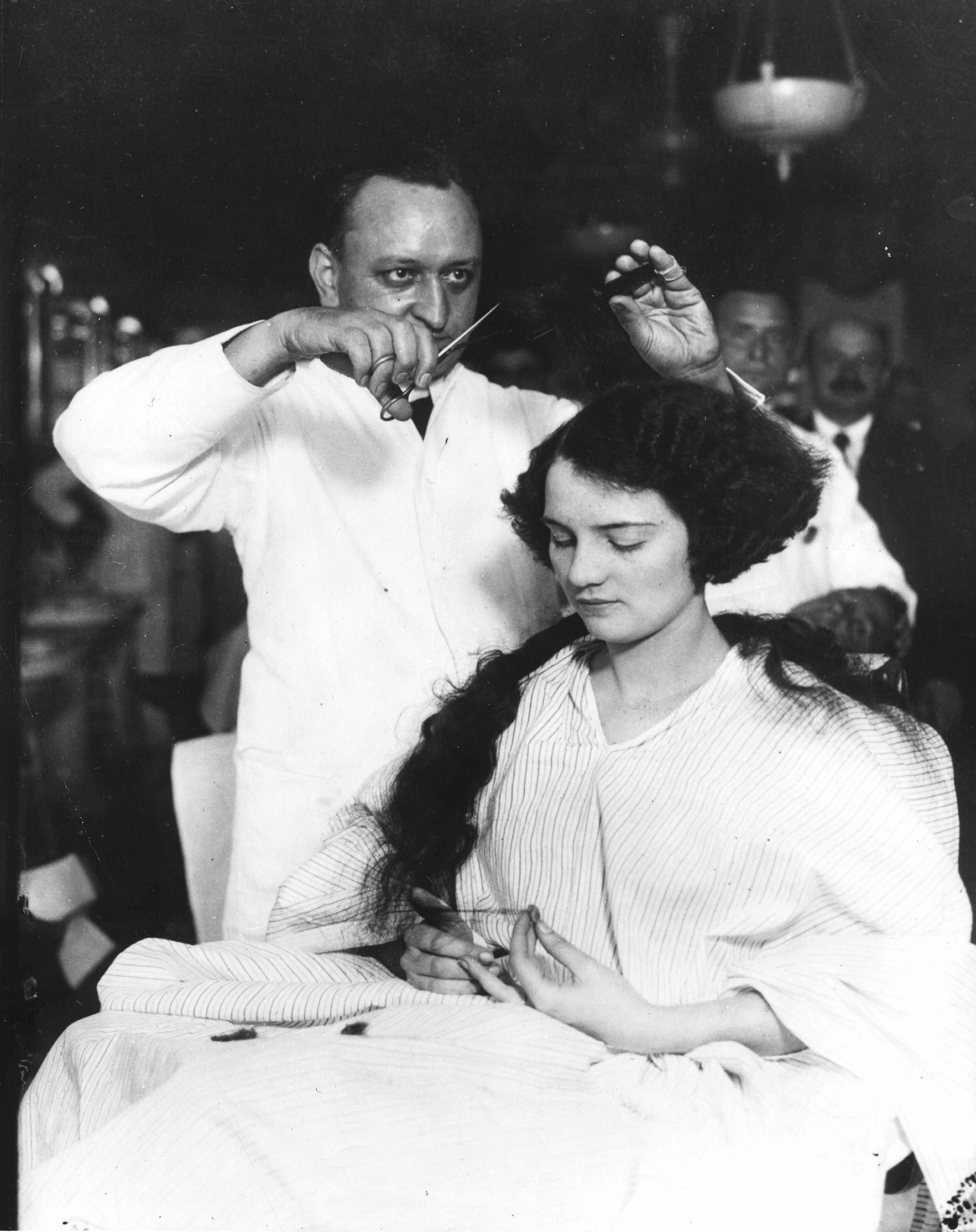 A young woman spurns centuries of tradition by getting her hair cut in to a bob at the start of the 20th century. (Photo by PhotoQuest/Getty Images)