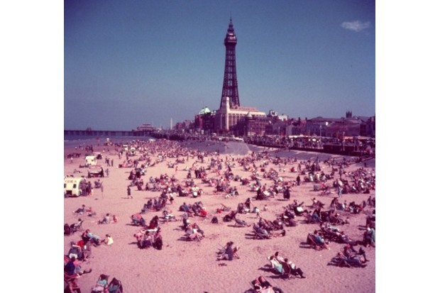 Sunbathers on Blackpool beach in 1954. (Credit: John Chillingworth/Getty Images)