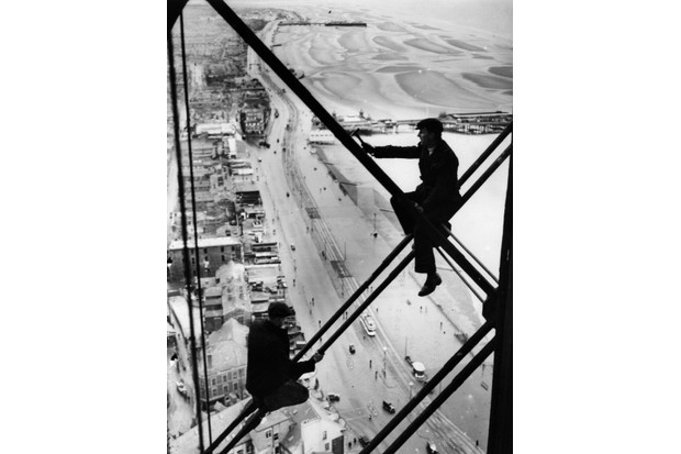 Men 500ft up Blackpool Tower where repairs are being carried out in 1947. The promenade and beach are clearly visible below. (Credit: Fox Photos/Getty Images)