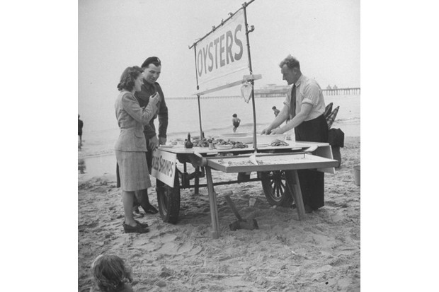 A couple buys seafood at Blackpool beach in 1945. (Credit: Ian Smith/The LIFE Picture Collection/Getty Images)