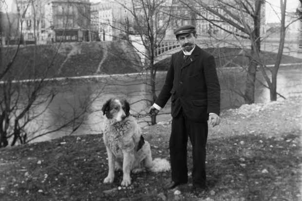 An attendant and his guard dog at the world's first pet cemetery, Paris,