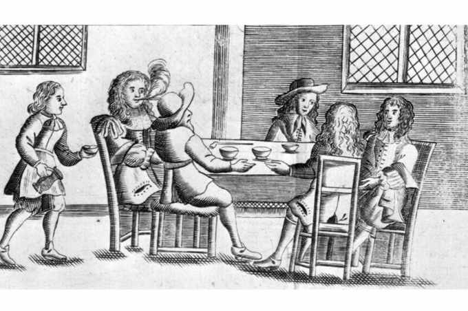 Men enjoying a drink and a chat in a coffee house, 1674. Coffee houses became known as 'schools of the wise', where people would gossip, argue and discuss the breaking news of the day. (Photo by Hulton Archive/Getty Images)