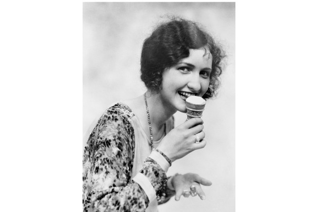 c1920s, woman in the US eating ice cream cone