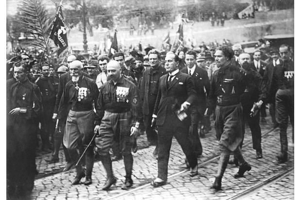 Benito Mussolini (centre right) joins other Fascist leaders, including (left to right) General Emilio de Bono, Cesare Maria De Vecchi and Count Italo Balbo, for a celebratory march after being sworn in as prime minister. (Photo by Getty Images)
