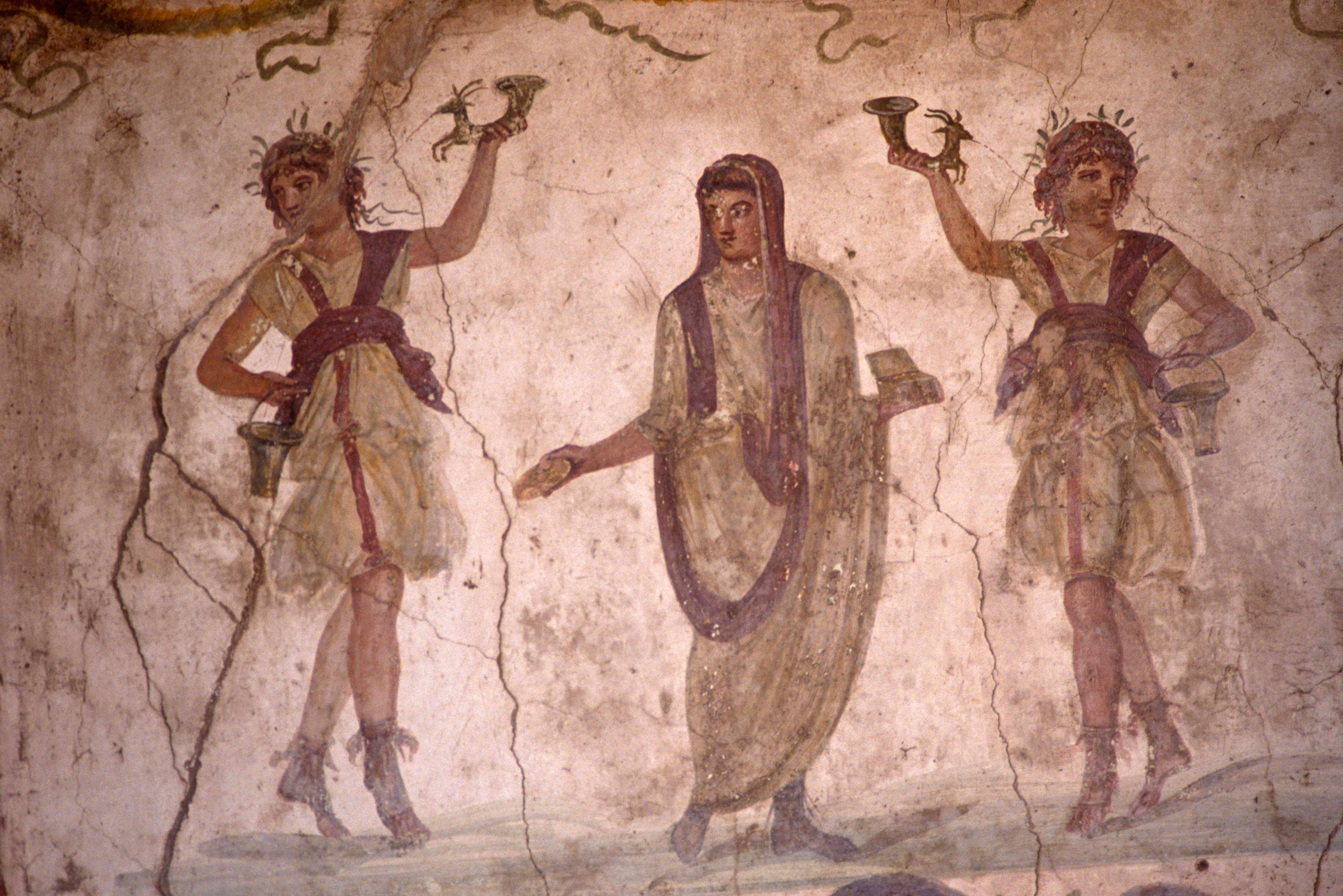 A fresco from the Villa of the Vettii in Pompeii. Painted before the catastrophic eruption of Versuvius, these frescoes were uncovered from beneath layers of volcanic ash and pumice. (Photo by In Pictures Ltd./Corbis via Getty Images)