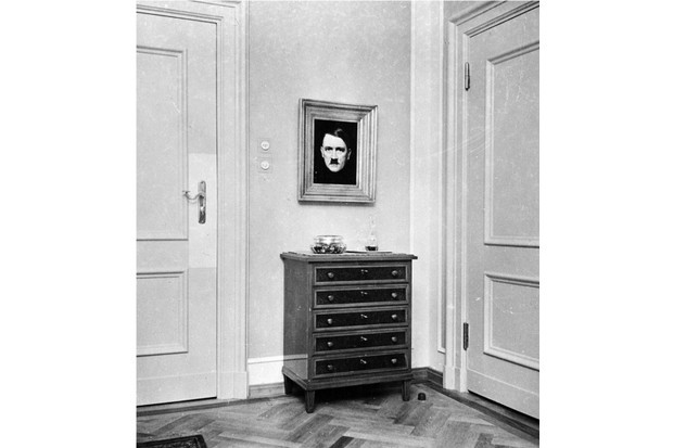 Photograph of Eva Braun's room in the Berghof with a framed Hitler portrait. This print is pasted into one of Eva Braun's photographic albums. (242-EB-12-2, Eva Braun Photographic Albums, National Archives, College Park, MD)