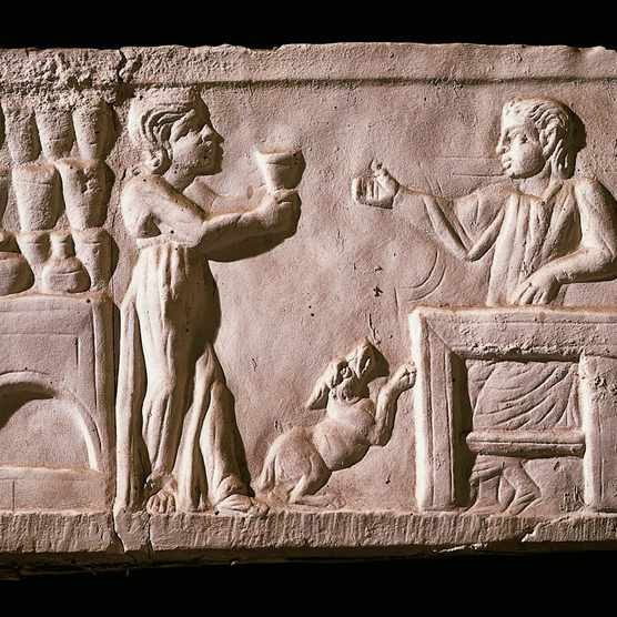 A relief portrays patrons of a Roman tavern. (Photo By DEA / A. DAGLI ORTI/De Agostini/Getty Images)