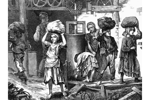 Young children carry heavy loads in a Midlands brickyard in this 1871 illustration from The Graphic, a weekly London newspaper. It has been estimated that between 20,000 and 30,000 children aged under 16 worked in British brickyards at the time. (Photo by Ann Ronan Pictures/Print Collector/Getty Images)
