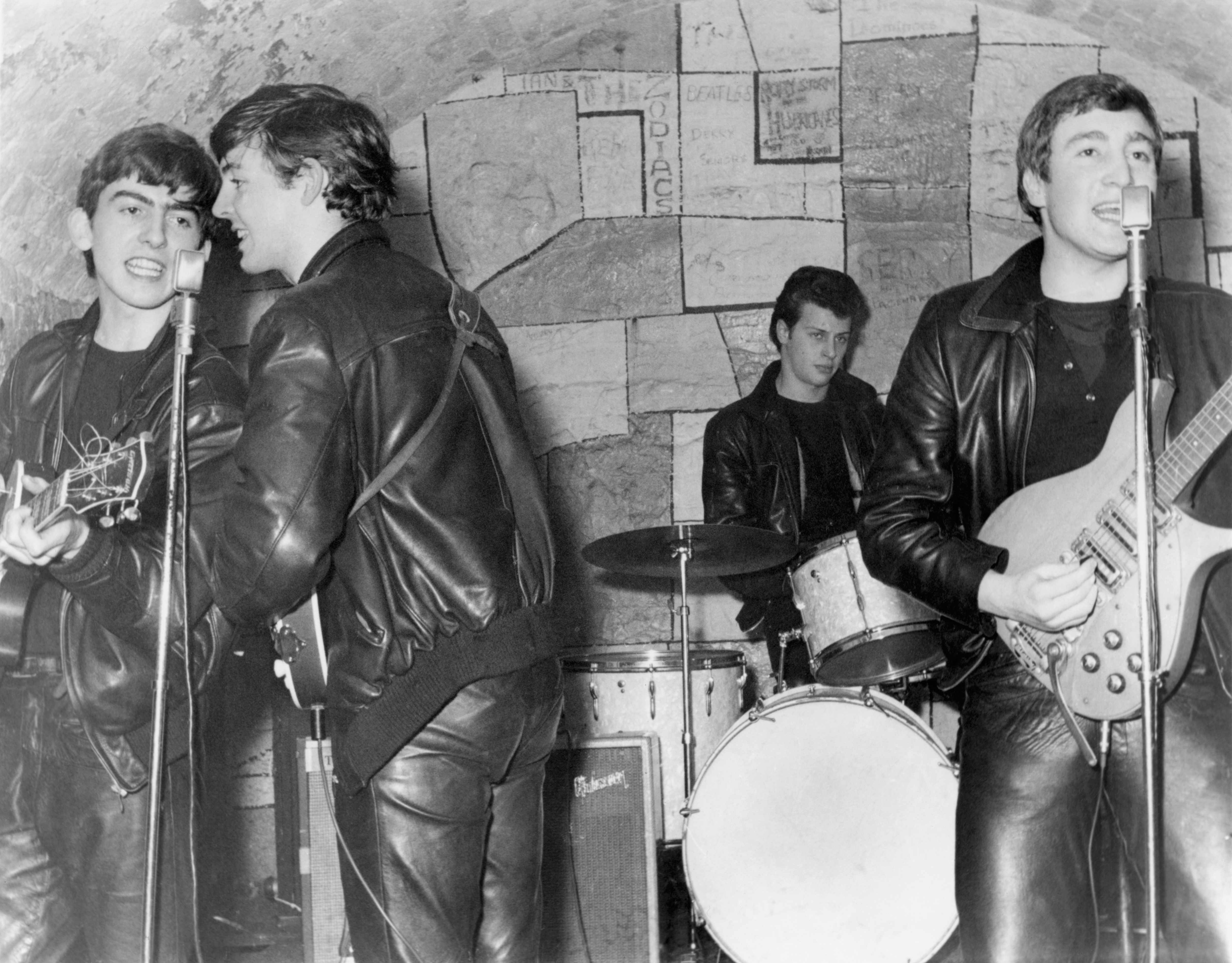 The Beatles perform onstage at the Cavern Club, Liverpool in February 1961. (Photo by Michael Ochs Archives/Getty Images)