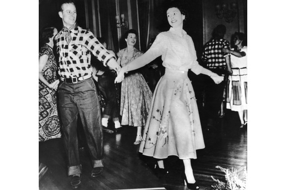 Princess Elizabeth and Prince Philip take part in a dance held in their honour in Ottawa, during their Canadian tour, on 17 October 1951. (Photo by Keystone/Hulton Archive/Getty Images)