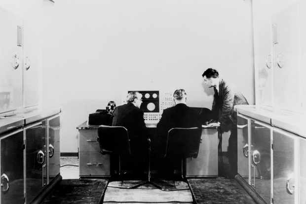 Alan M Turing and colleagues working on the Ferranti Mark I Computer, 1951.