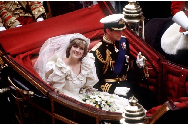 Princess Diana and Prince Charles ride in an open-top car following their wedding.